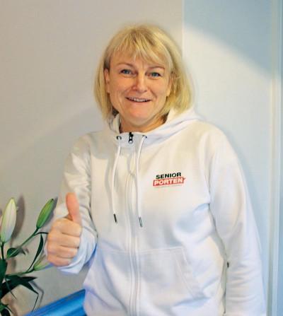 En glad Marie Hedlund, verksamhetsansvarig på SeniorPorten ser fram emot ett gott nytt 2018 för Sveriges seniorer.